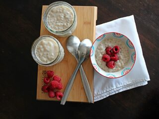 tapioca pudding in a bowl with 2 spoons.