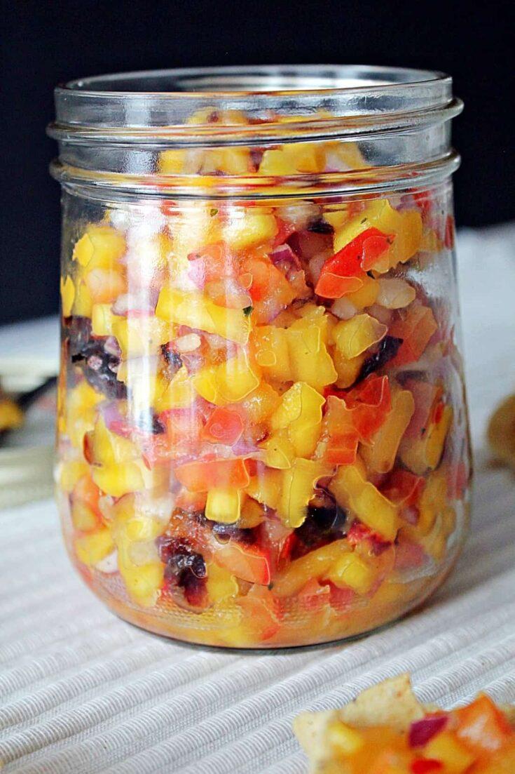 cranberry mango salsa in a mason jar.