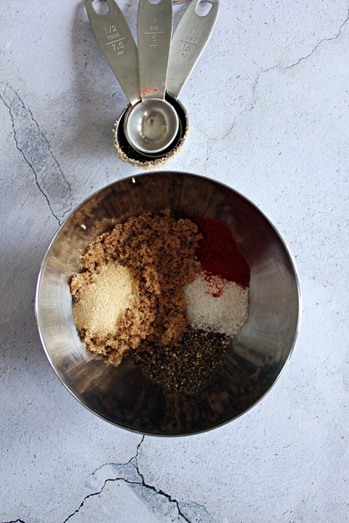 Smoked Pork rub ingredients in a stainless steel bowl.