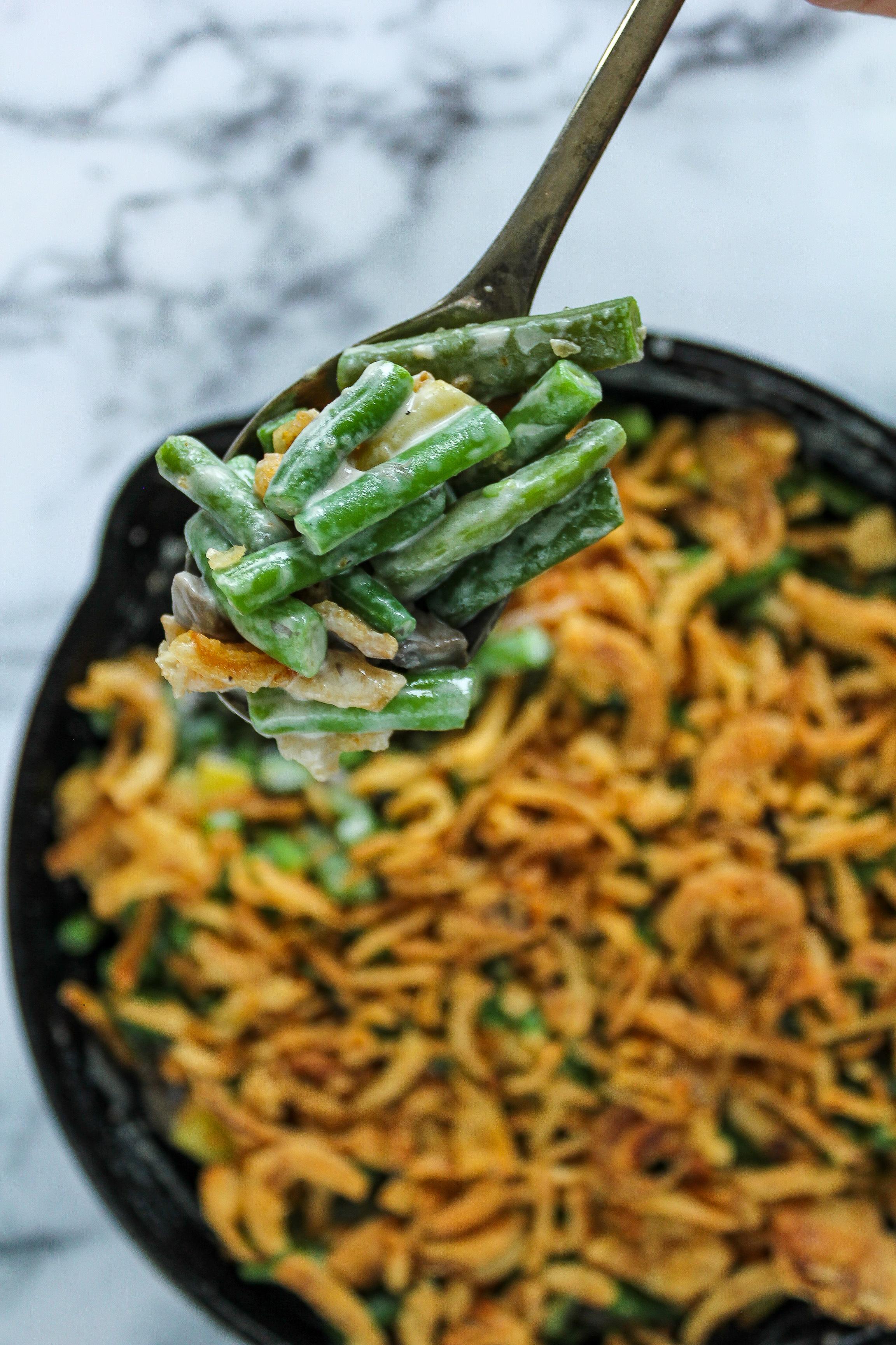 A spoon full of green bean casserole.