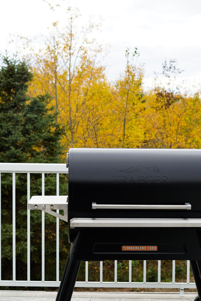 Traeger Timberline 1300 on a deck with fall leaves in the background.