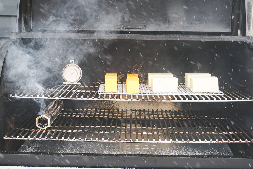 Cheese on the smoker - a smoke tube is burning.