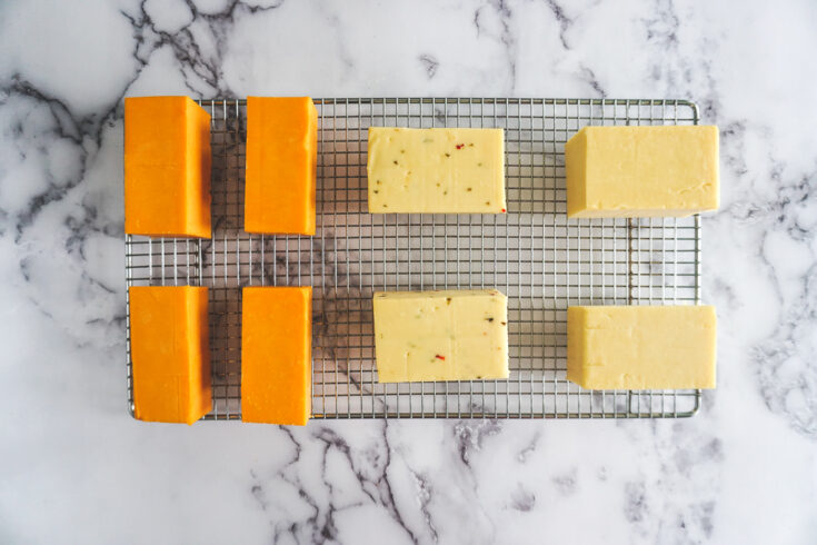 Smoked cheese on a wire mesh rack.