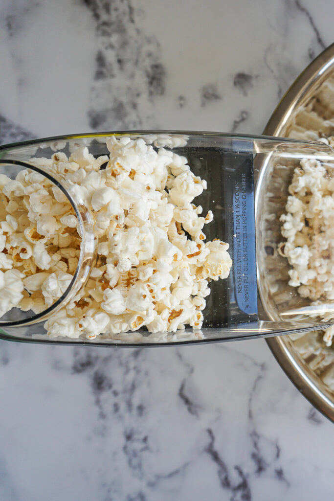Popped popcorn rising up in an air popper.