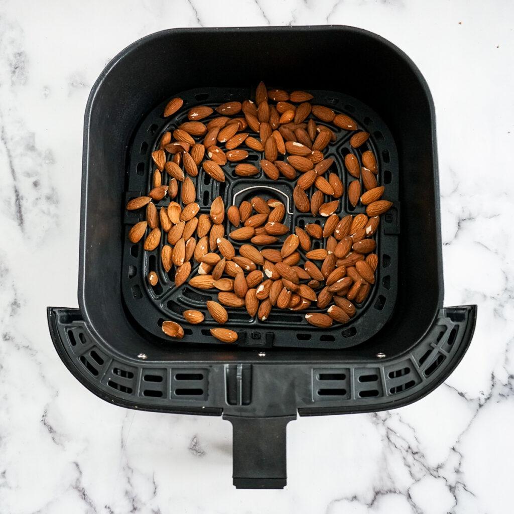 Raw almonds in an air fryer.