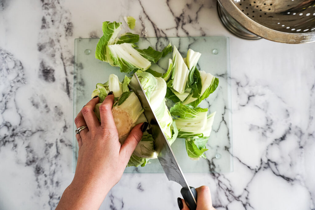 Chopping the leaves off of the cauliflower.