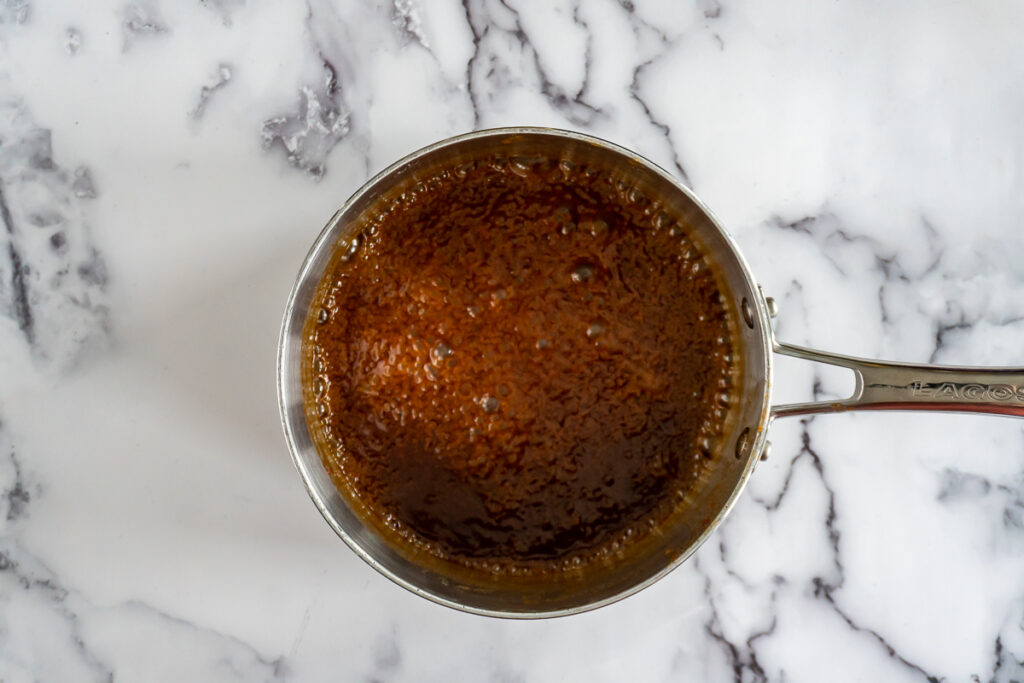 Bringing the caramel to a boil.