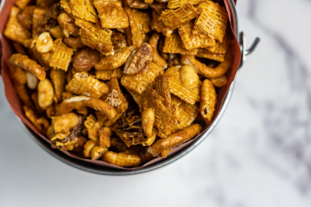 Close up of the sriracha caramel coating on the chex mix.