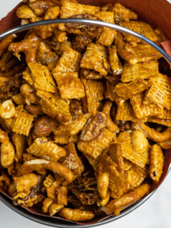 Smoked chex mix in a bucket.