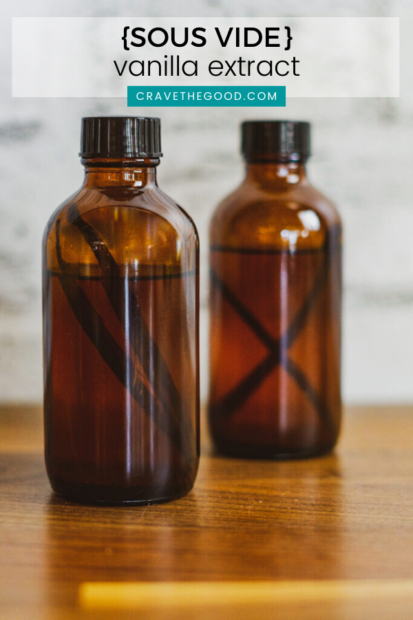 Two bottles of vanilla extract with vanilla beans in them.