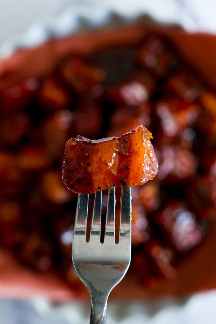 A smoked burnt end on a fork.