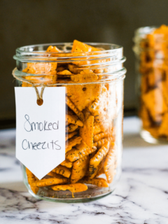 Smoked Cheezits in a glass jar with a white label.