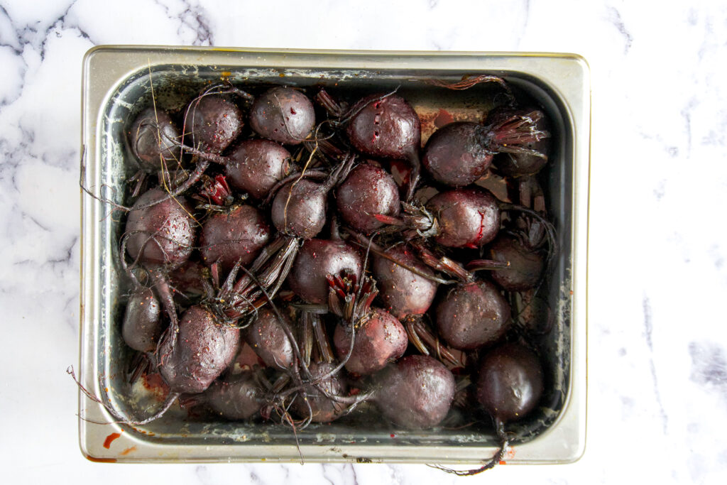 Cooked beets in a chafing pan.