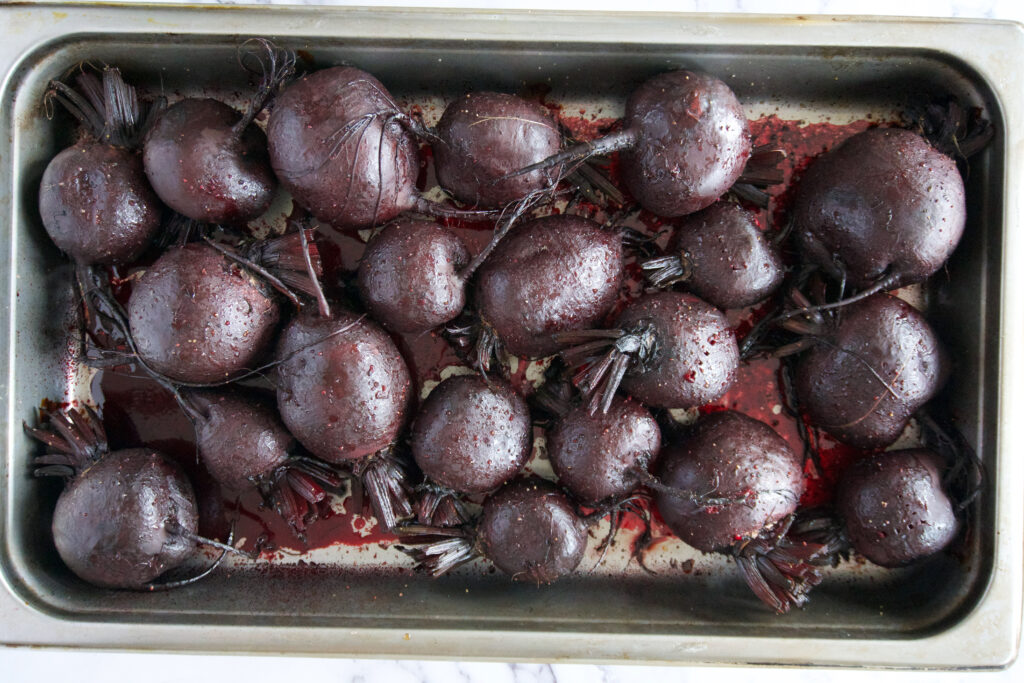 Roasted beets in a pan.