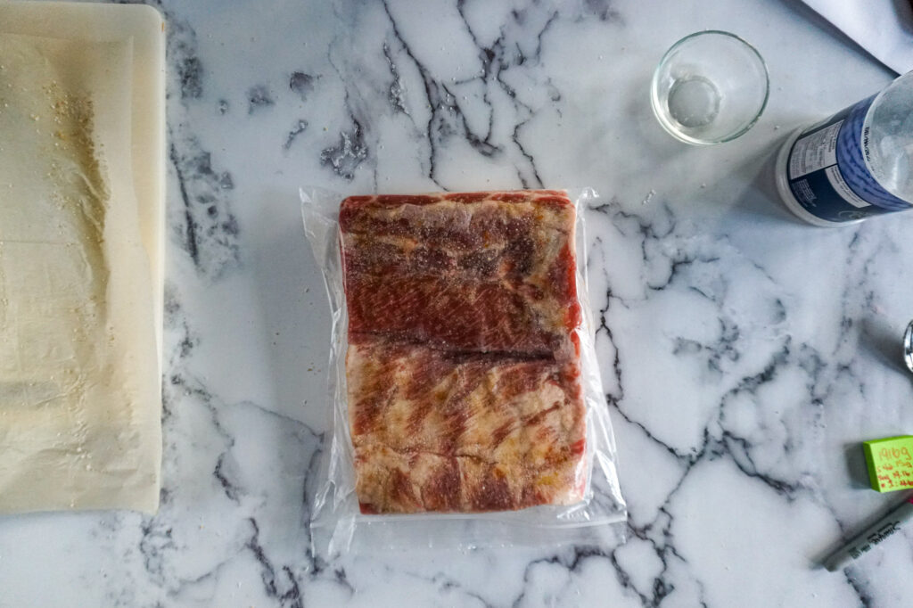 Dry cure rubbed pork belly in the ziplock bag.