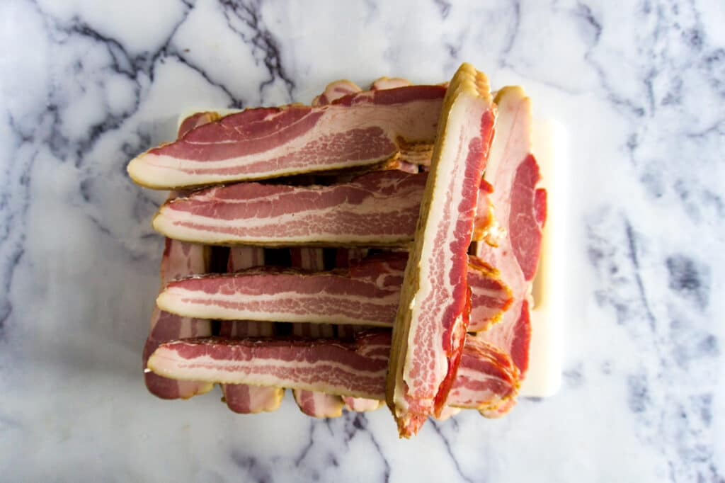 Stacked sliced bacon.