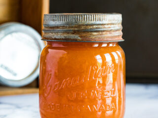 Smoked peach jam in a gem mason jar.