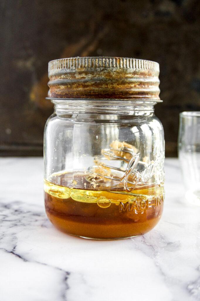 Unmixed apple cider vinegar salad dressing.
