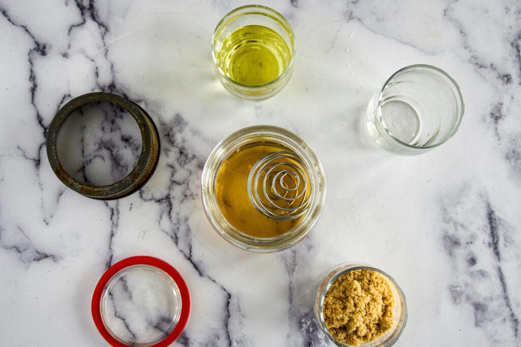 Apple cider vinegar added to a mason jar.