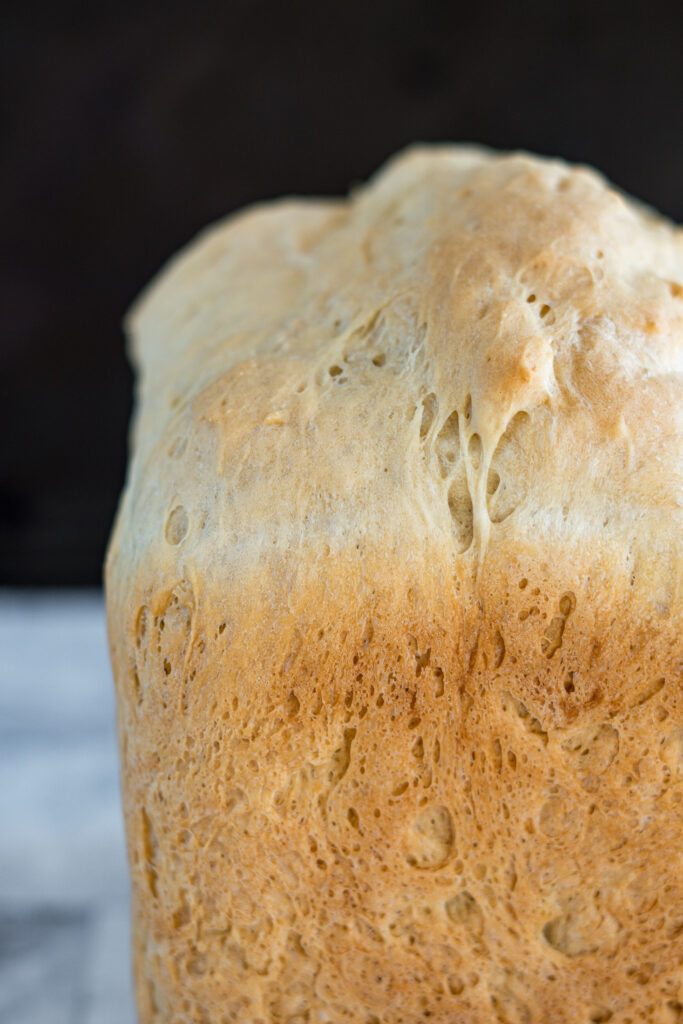 Side profile of a machine baked loaf of bread.