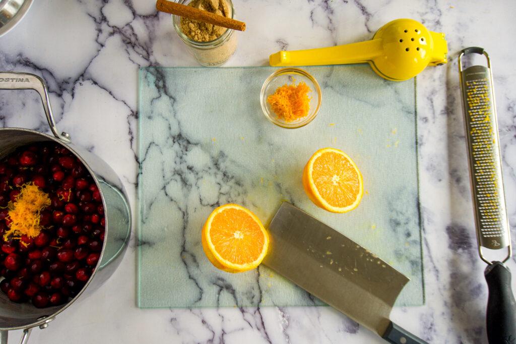 Zested orange sliced in half.