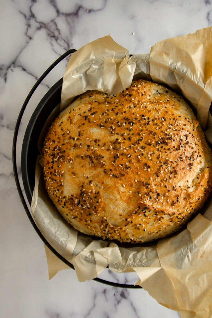 Everything Bagel Bread in a cast iron dutch oven.