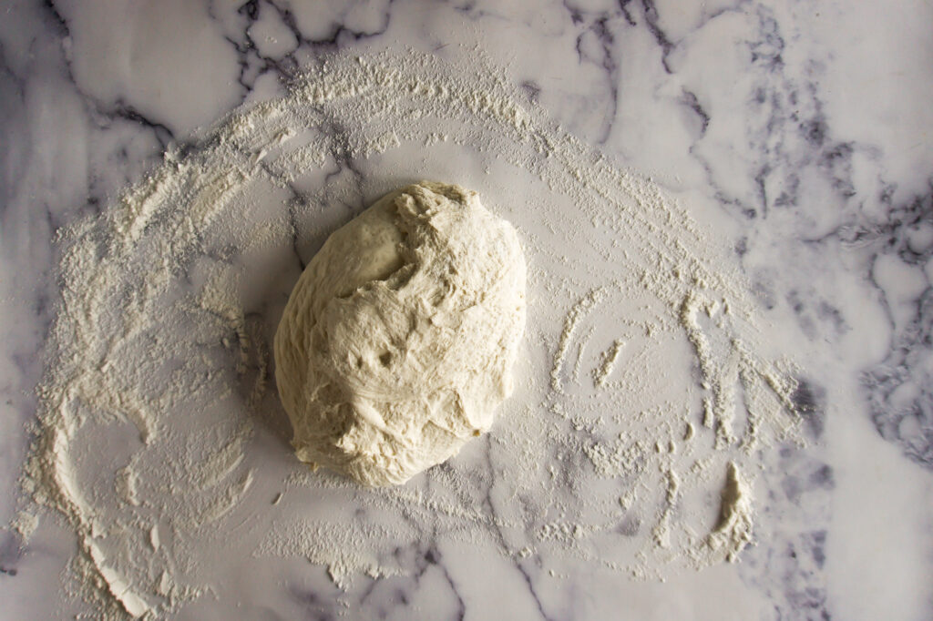 Bread dough turned onto the floured surface.