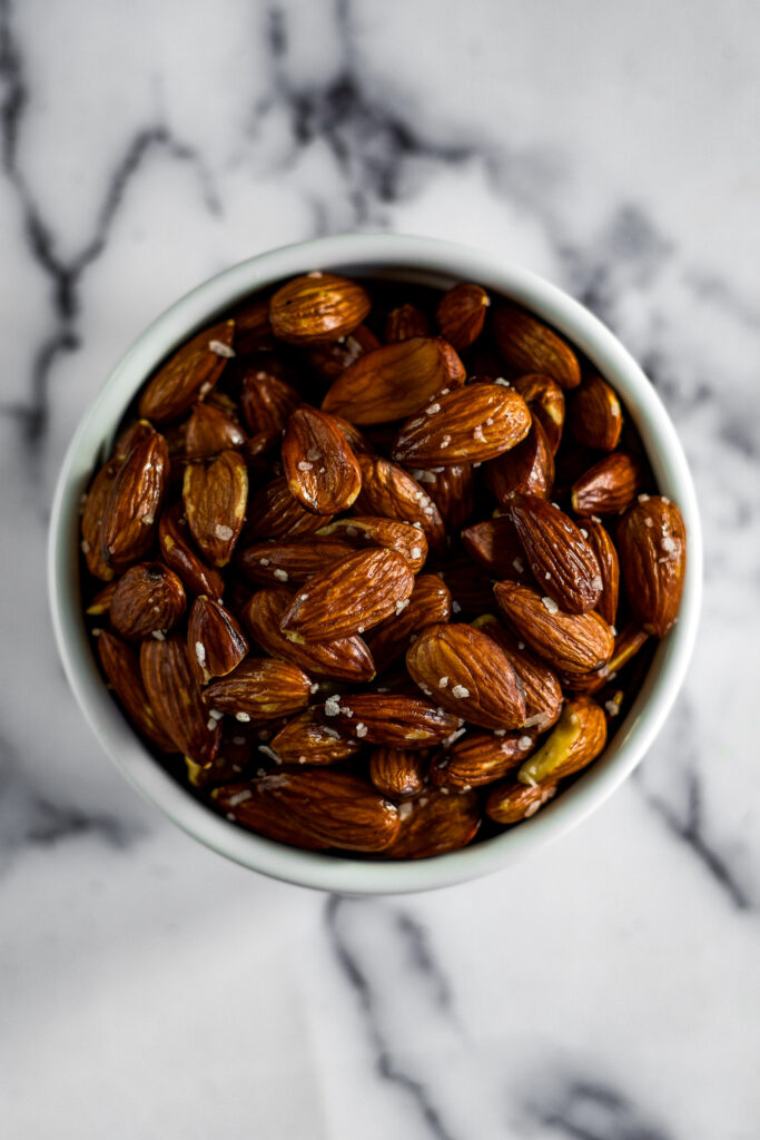 Overhead view of salted smoked almonds.