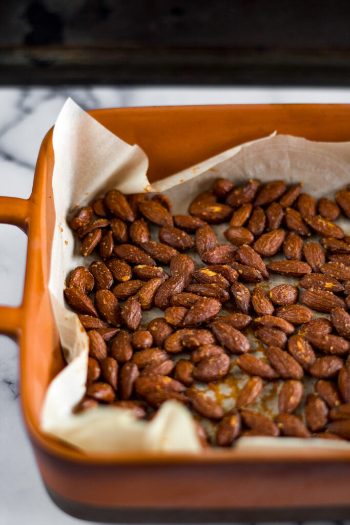 Sweet and spicy smoked almonds in a baking dish.