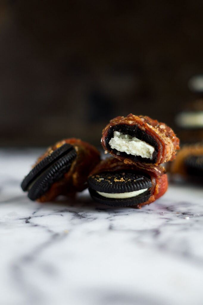 Stacked bacon wrapped oreo cookies.