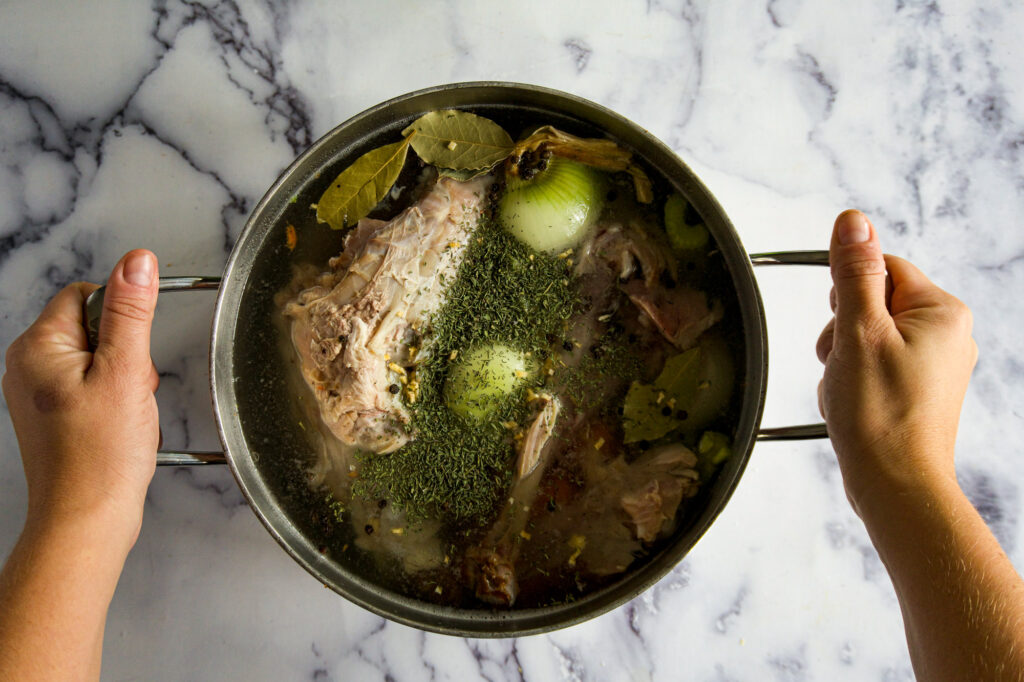 Stockpot with soup and seasonings.