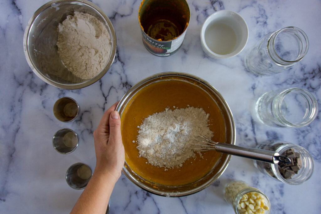 Adding flour in batches.