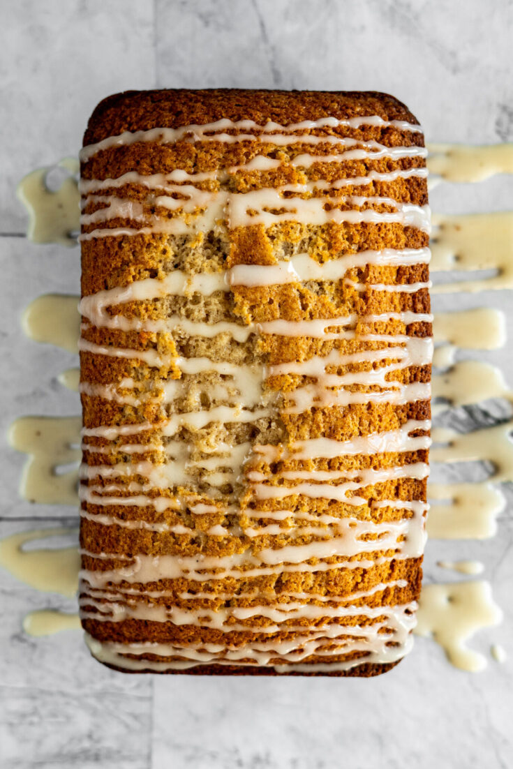 Eggnog bread drizzled with eggnog glaze.