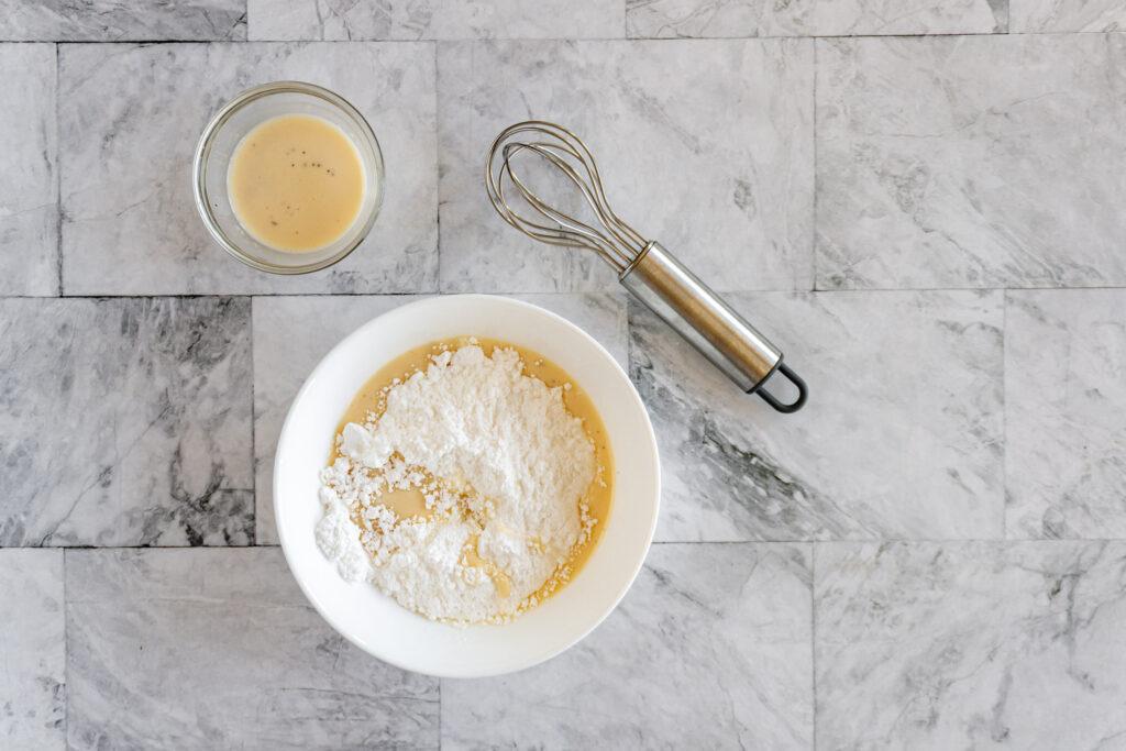 Eggnog added to the powdered sugar.