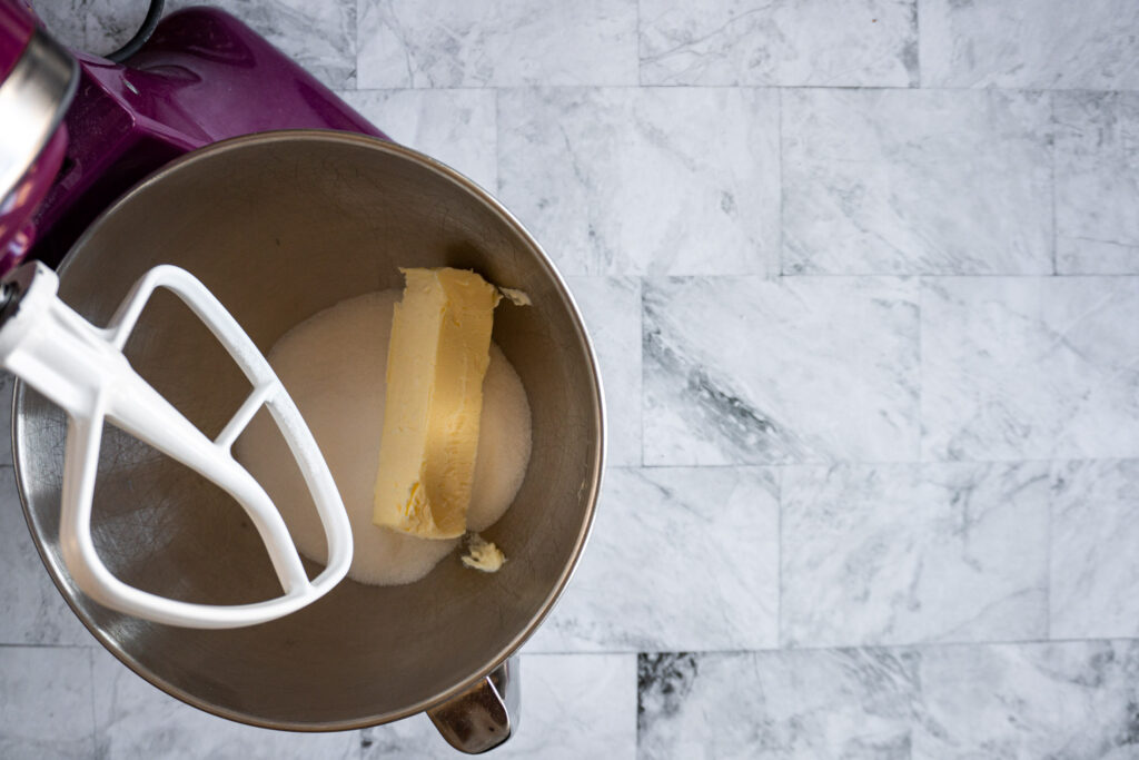 Softened butter and granulated sugar in the bowl of a stand mixer.
