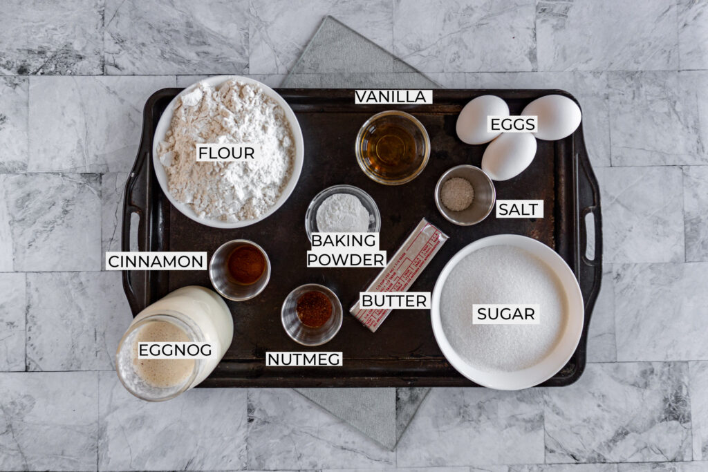 Ingredients required for eggnog bread organized in a sheet pan.