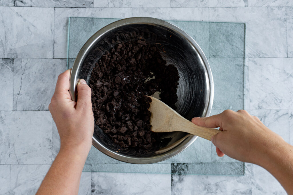 Stirring in the chocolate sauce.