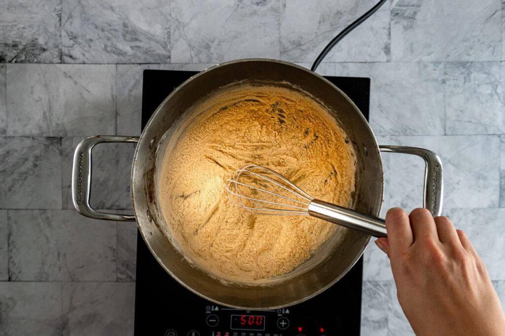Browned flour in a pot.