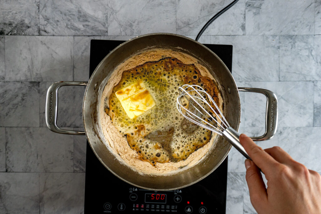 Melting butter in the flour.