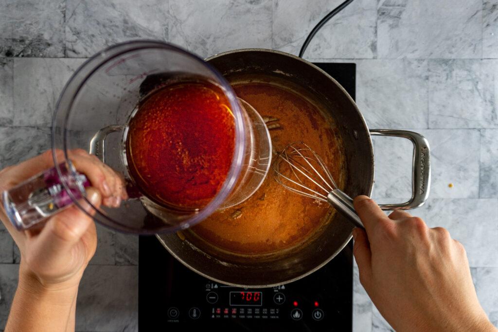 Adding pan drippings.