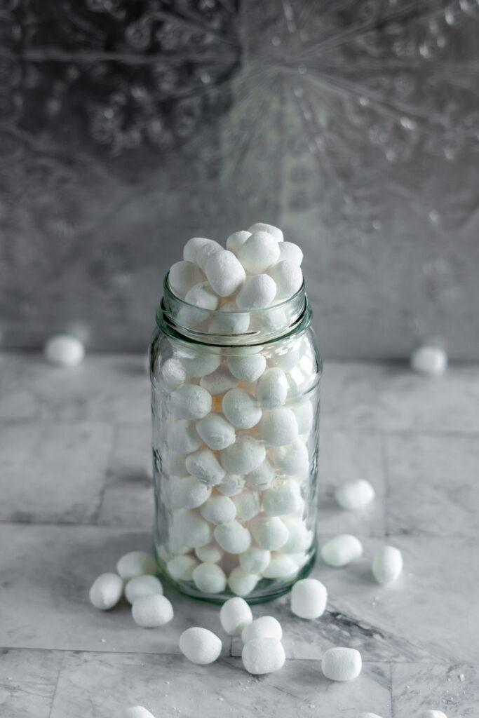 Dehydrated marshmallows piled high in a mason jar.