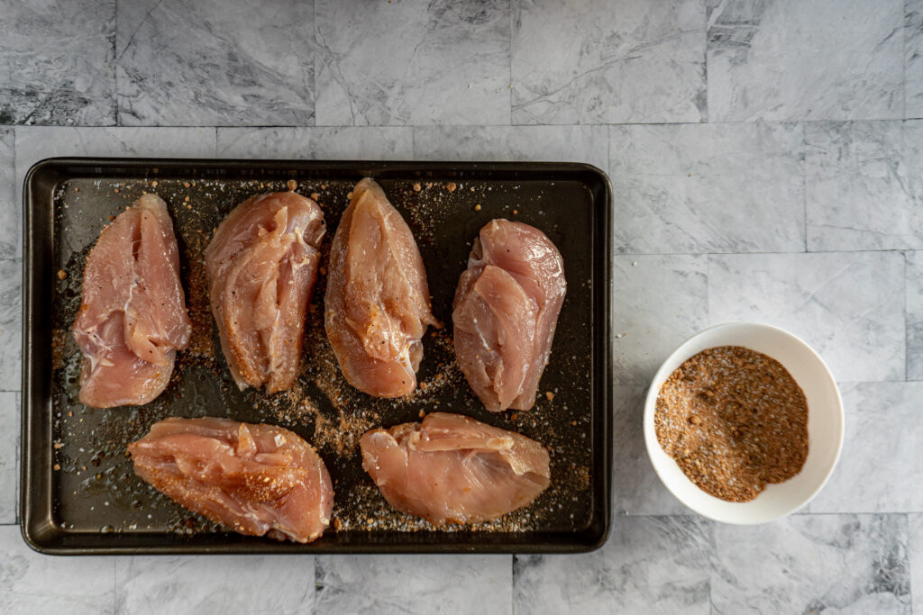 Flipped over chicken breasts showing no rub.
