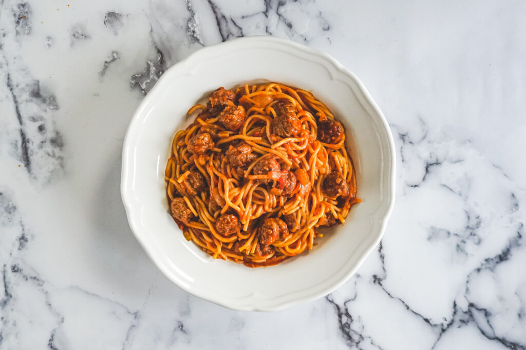 Spaghetti served up in a white dish.