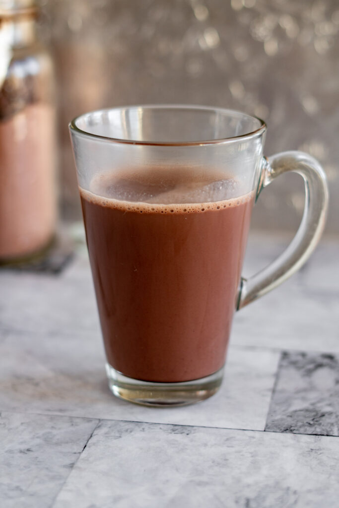 Mixed hot cocoa in a glass mug.