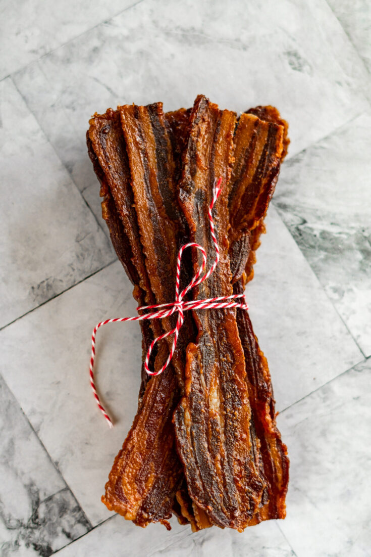 Bacon jerky wrapped in red and white twine.