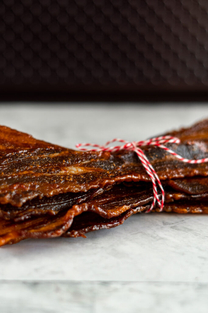 Showing the texture of the side of the bacon jerky.