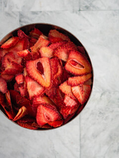 A bowl of dehydrated strawberry chips.