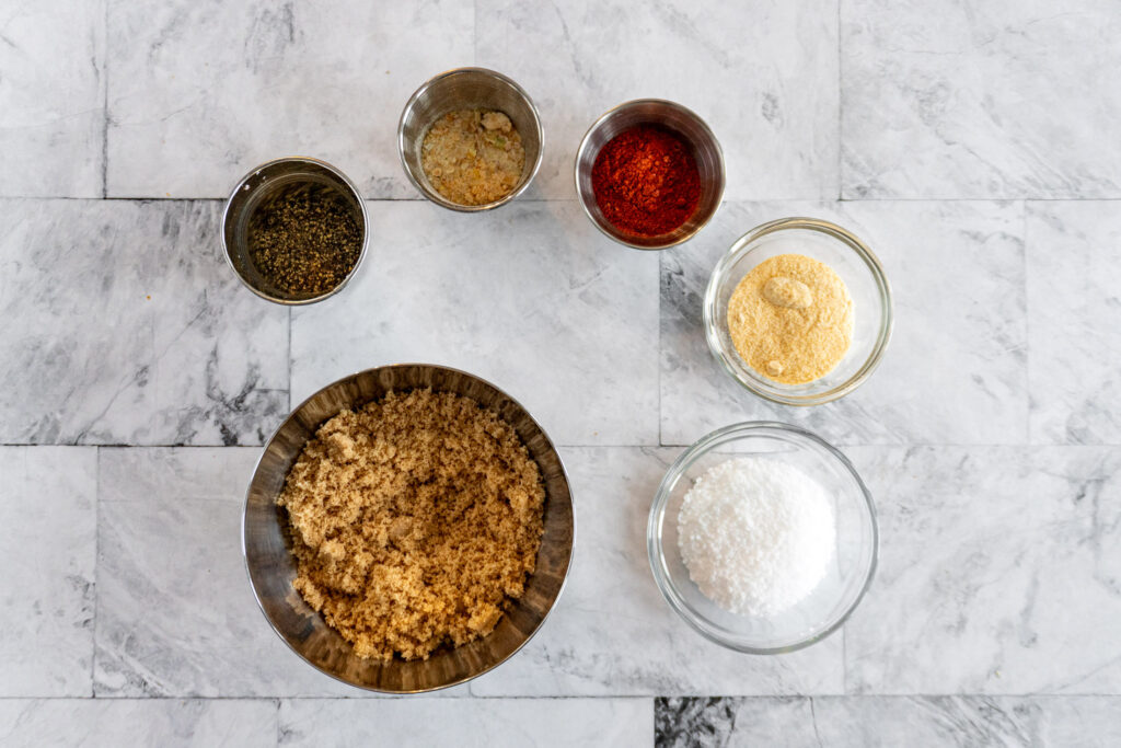 A photo of all the rub ingredients in individual bowls.
