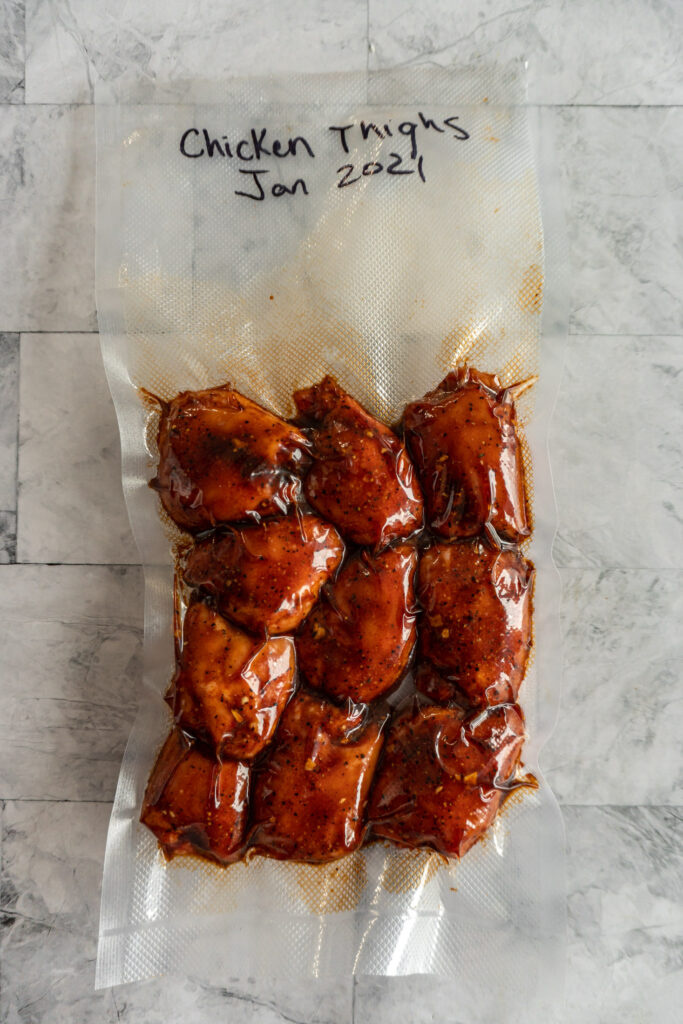 Traeger smoked chicken thighs sealed in a vacuum bag.