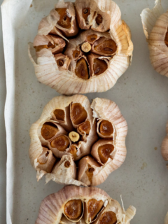 Smoked garlic bulbs with browned garlic inside the bulb.